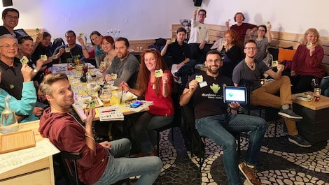Thyago Ohana, Duolingo Ambassador in Vienna, and a group of learners in a Duolingo Event.